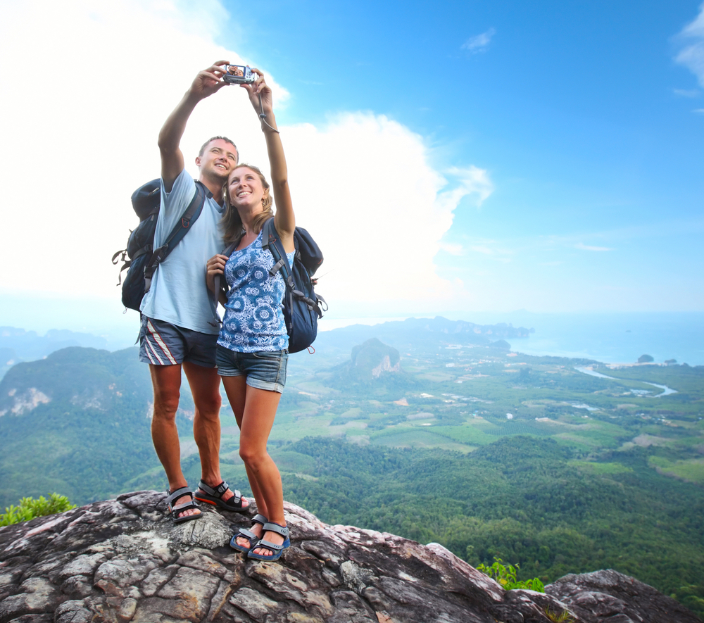 travel couple taking selfie