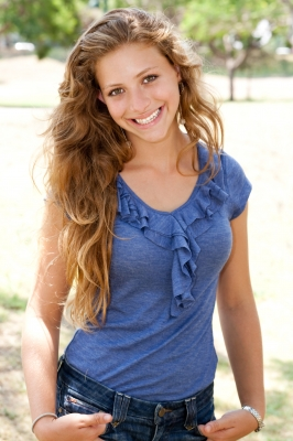 Woman In Blue Blouse Smiling
