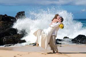 Wedding couple by the ocean waves